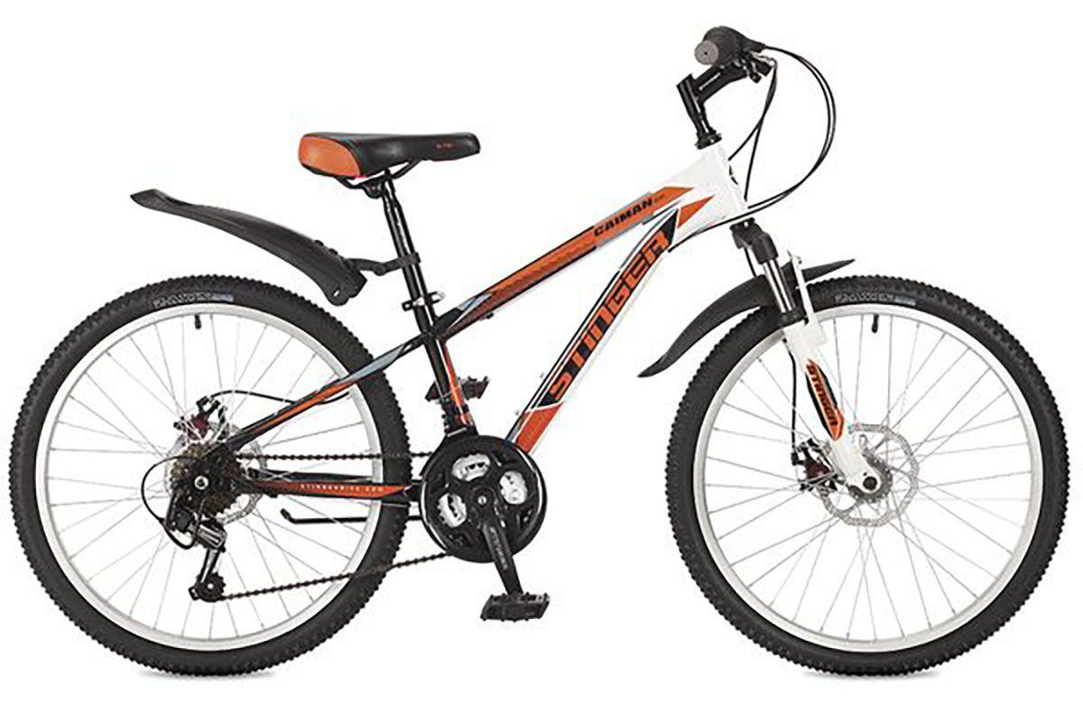Велосипед Stinger Caiman D 24 (2016) синий 12.5ОТ 9 ДО 13 ЛЕТ (24-26 ДЮЙМОВ)<br>Велосипед Stinger Caiman D 24 создан на базе прочной стальной рамы и оборудован надёжными механическими тормозами, которые не подведут даже в сложных погодных условиях. Трансмиссия велосипеда имеет 18 скоростей, что позволяет подобрать оптимальную нагрузку. Колёса велосипеда имеют двойные обода, устойчивые к нагрузкам. Велосипед Stinger Caiman D 24 подходит подросткам 9 – 13 лет имеющих рост 127-155 см.<br><br>бренд: STINGER<br>год: 2018<br>рама: Сталь (Hi-Ten)<br>вилка: Амортизационная (пружина)<br>блокировка амортизатора: Нет<br>диаметр колес: 24<br>тормоза: Дисковые механические<br>уровень оборудования: Начальный<br>количество скоростей: 18<br>Цвет: синий<br>Размер: 12.5