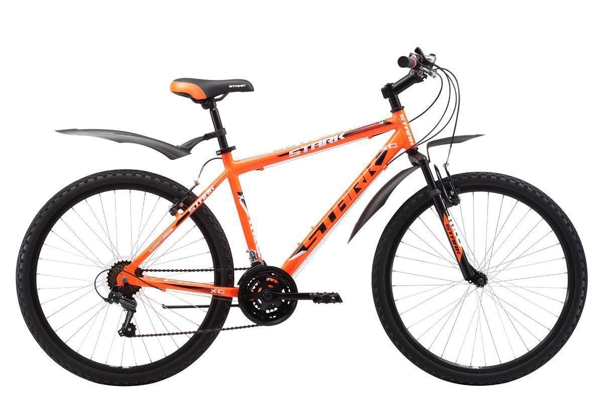 Велосипед Stark Outpost 26.1 V (2017) оранжево-черный 16КОЛЕСА 26 (СТАНДАРТ)<br>Популярная модель горного велосипеда в линейке бренда Stark. Велосипед имеет легкую алюминиевую раму, мягкую амортизационную вилку, которая хорошо сглаживает и смягчает неровности дороги. Stark Outpost 26.1 V оборудован полуинтегрированной рулевой колонкой и ободными тормозами типа V-brake. В 2017 году модель была усовершенствована. Изменения, прежде всего, коснулись трансмиссии, которая теперь имеет 21 передачу #40; в моделях прошлых лет всего 18#41;. На новой модели установлены триггерные манетки SHIMANO. Помимо этого производитель добавил кольцо под вынос, благодаря чему руль может устанавливаться выше.<br><br>бренд: STARK<br>год: 2017<br>рама: Алюминий (Alloy)<br>вилка: Амортизационная (пружина)<br>блокировка амортизатора: Нет<br>диаметр колес: 26<br>тормоза: Ободные (V-brake)<br>уровень оборудования: Начальный<br>количество скоростей: 21<br>Цвет: оранжево-черный<br>Размер: 16