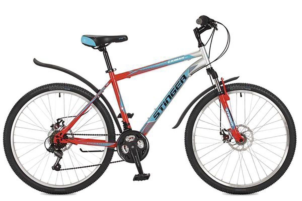 Велосипед Stinger Caiman D 26 (2016) черный 16КОЛЕСА 26 (СТАНДАРТ)<br>Stinger Caiman D 26 – недорогой горный велосипед на стальной раме. Велосипед отлично подходит для езды по различным типам дорог. Передняя амортизационная вилка хорошо сглаживает неровности дороги, тем самым снимая лишнюю нагрузку с рук. Дисковый механический тормоз обеспечивает качественное торможение на любом типе дорожного покрытия. Велосипед Stinger Caiman D 26 оборудован 18-ти скоростной трансмиссией и системой переключения передач Shimano.<br><br>бренд: STINGER<br>год: 2017<br>рама: Сталь (Hi-Ten)<br>вилка: Амортизационная (пружина)<br>блокировка амортизатора: Нет<br>диаметр колес: 26<br>тормоза: Дисковые механические<br>уровень оборудования: Начальный<br>количество скоростей: 18<br>Цвет: черный<br>Размер: 16