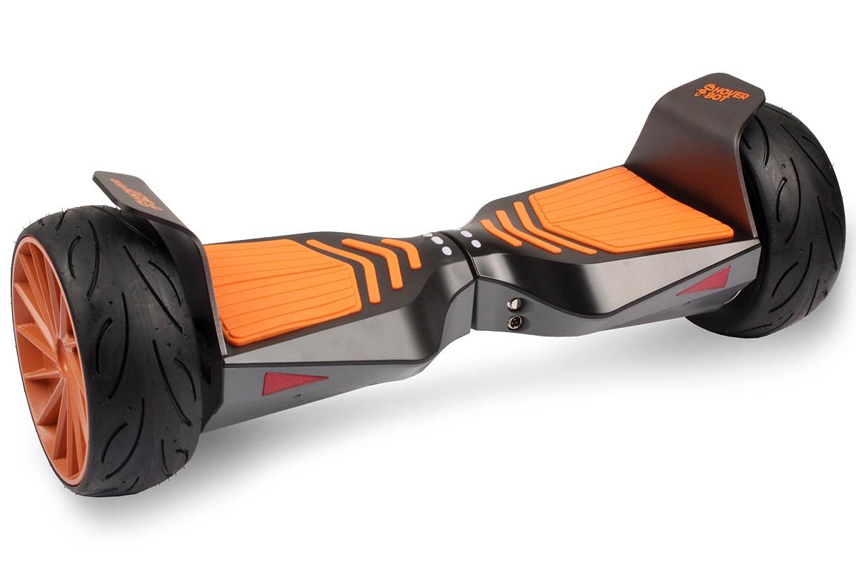Гироскутер Hoverbot B-11 Premium чёрныйГИРОСКУТЕРЫ<br>Hoverbot B-11 Premium - новейший дизайн от ТМ Hoverbot. Идеальная доска для городских условий и езды по паркам. Широкие колёса и удобные прорезиненные педали обеспечивают дополнительную уверенность и максимальную устойчивость при езде на высоких скоростях. Высокий клиренс гироскутера позволяет без боязни преодолевать невысокие препятствия на пути. B-11 имеет уникальную чёрно оранжевую расцветку. Металлические диски имеют большой радиус, что визуально увеличивают размер колёс. Данная модель гироскутера подойдёт продвинутым пользователям, которые уверенно чувствуют себя на дороге. К устройству можно подключиться через мобильное приложение, которое компания Hoverbot разработала специально под Premium линейку гироскутеров. Через приложение вы можете настраивать гироскутер под свой индивидуальный стиль езды: ставить и убирать ограничения максимальной скорости; настраивать динамику набора скорости; отслеживать на спидометре максимальную скорость вашего устройства; отслеживать пройденный маршрут #40;на карте и общую дистанцию в км.#41;; контролировать уровень заряда батареи; ставить или менять пароль на своё устройство. Подключение к устройству происходит посредством встроенного bluetooth передатчика в гироскутере и в вашем мобильном устройстве. Также B-10 оснащён 2 динамиками в нижней части корпуса, поэтому по желанию вы можете воспроизводить свою любимую музыку, аудио файлы, слушать радио через динамики устройства. Просто подключитесь к своему устройству по bluetooth и включите музыку через любой встроенный аудиоплеер, либо приложение. В комплект входит сумка-кофр и зарядное устройство.<br><br>бренд: HOVERBOT<br>год: 2018<br>рама: None<br>вилка: None<br>блокировка амортизатора: None<br>диаметр колес: 8,5<br>тормоза: None<br>уровень оборудования: None<br>количество скоростей: None<br>Цвет: чёрный<br>Размер: None