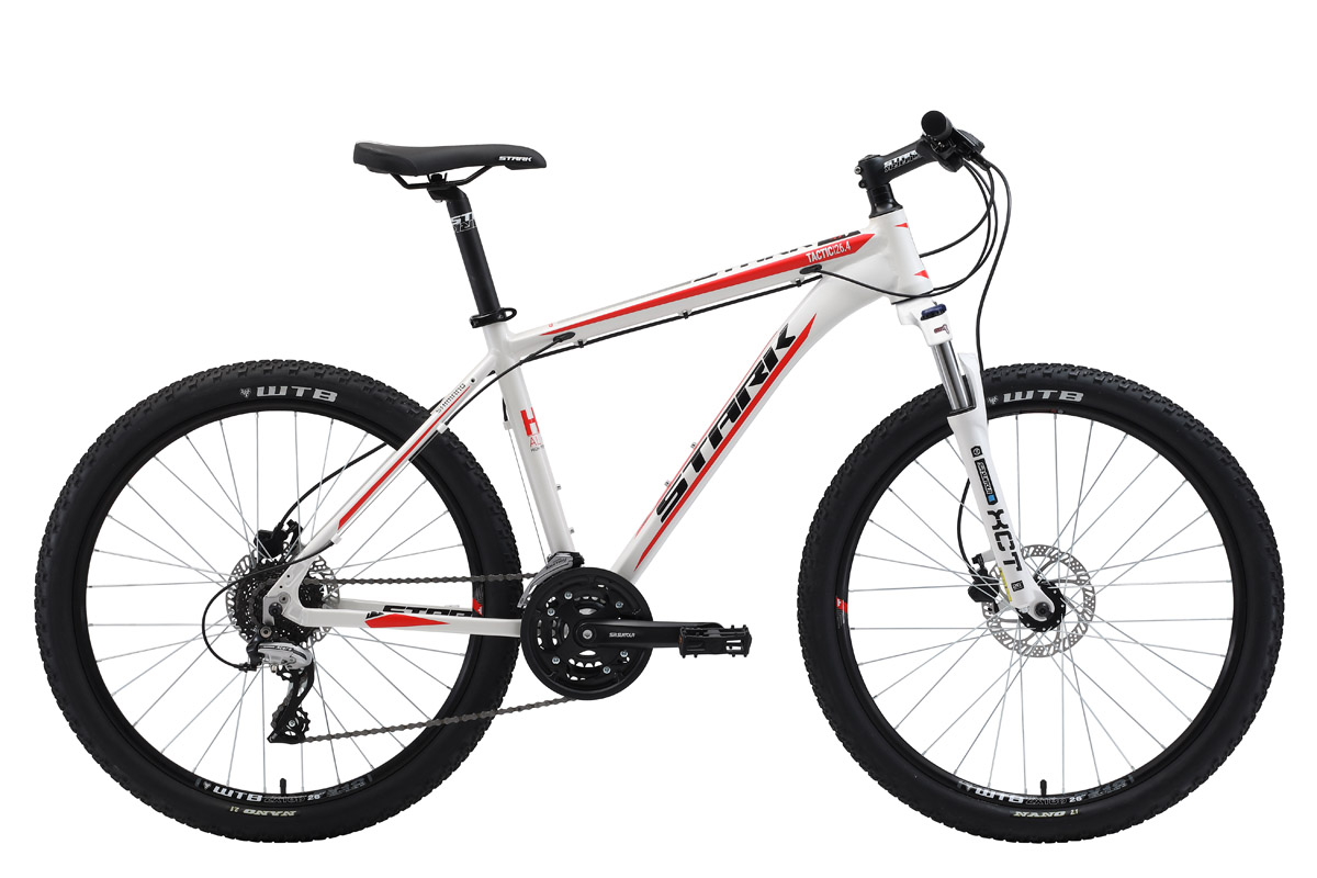 Велосипед Stark Tactic 26.4 HD (2018) белый/красный/чёрный 18КОЛЕСА 26 (СТАНДАРТ)<br>Оборудованный гидравлическими дисковыми тормозами, горный велосипед Stark Tactic 26.4 HD имеет отличные технические характеристики и привлекательный внешний вид. Рама велосипеда, изготовленная из лёгкого и прочного алюминиевого сплава, с применением технологии двойного баттинга, имеет полированные швы, а так же внутреннюю проводку тросов. Трансмиссия велосипеда имеет 24 скорости, что позволяет точно подобрать нагрузку. Навесное оборудование, а именно переключатели скоростей #40;передний и задний#41;, кассета и монетки - известного бренда Shimano. Stark Tactic 26.4 HD укомплектован подножкой и пластиковыми крыльями.<br><br>бренд: STARK<br>год: 2018<br>рама: Алюминий (Alloy)<br>вилка: Амортизационная (масло)<br>блокировка амортизатора: Да<br>диаметр колес: 26<br>тормоза: Дисковые гидравлические<br>уровень оборудования: Любительский<br>количество скоростей: 24<br>Цвет: белый/красный/чёрный<br>Размер: 18