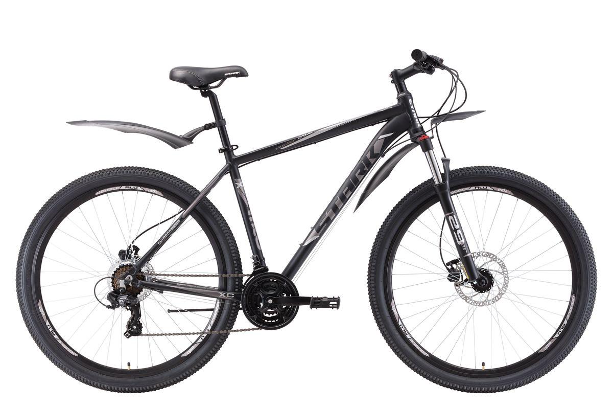 Велосипед Stark Hunter 29.2 HD (2018) тёмно-серый/чёрный/серый 22КОЛЕСА 29 (НАЙНЕРЫ)<br>Горный велосипед Stark Hunter 29.2 HD #40;2018#41; - найнер, предназначенный для прогулочного катания на природе. Велосипед собран на крепкой алюминиевой раме и имеет увеличенный диаметр колёс - 29 дюймов. Передняя вилка, с пружинным амортизатором, снимает часть нагрузки с рук при катании по ухабистым дорогам. Торможение обеспечивают дисковые гидравлические тормоза Tektro HD-M285, с диаметром переднего ротора 180 мм. 21 передача позволяет велосипедисту подобрать оптимальную нагрузку в любых условиях. Переключение передач выполняется с помощью оборудования Shimano, туристического уровня - Tourney. Для управления передачами, на руле установлены курковые переключатели. В базовой комплектации велосипеда Stark Hunter 29.2 HD #40;2018#41; установлены крылья и подножка.<br><br>бренд: STARK<br>год: 2018<br>рама: Алюминий (Alloy)<br>вилка: Амортизационная (пружина)<br>блокировка амортизатора: Да<br>диаметр колес: 29<br>тормоза: Дисковые гидравлические<br>уровень оборудования: Начальный<br>количество скоростей: 21<br>Цвет: тёмно-серый/чёрный/серый<br>Размер: 22