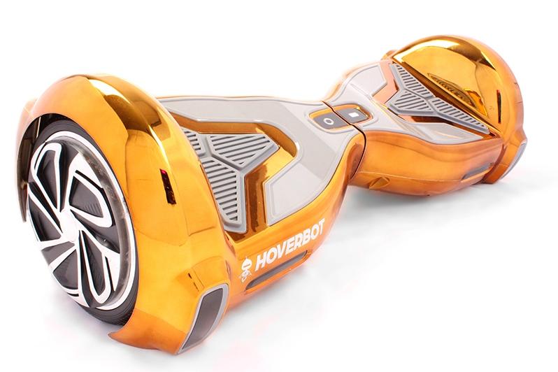 """Гироскутер Hoverbot A-15 Premium золотойГИРОСКУТЕРЫ<br>Hoverbot A-15 PREMIUM - это не просто гироскутер, а мини-спорткар! В нем гармонично сочетается дизайн и отличные ходовые характеристики. Колеса диаметром 6,5"""" дюймов и мощный мотор обеспечивают комфортное, резвое движение по асфальту. За счет выступов на корпусе не дает устройству опрокидываться. Нескользящие педали - обязательная деталь каждого гироскутера – для вашей безопасности. Такой транспорт удобно брать с собой благодаря размеру. Данная модель оснащена Bluetooth-передатчиком, который позволяет подключаться к любому гаджету и воспроизводить любимую музыку через встроенные колонки! Фары с увеличенной яркостью позволяют кататься даже в темное время суток. Такой гироскутер станет не только красивым, но и практичным подарком для детей и взрослых! Уникальное дополнение: для данной модели разработано мобильное приложение, с помощью которого можно настроить свой гироскутер.<br><br>бренд: HOVERBOT<br>год: 2018<br>рама: None<br>вилка: None<br>блокировка амортизатора: None<br>диаметр колес: 6,5<br>тормоза: None<br>уровень оборудования: None<br>количество скоростей: None<br>Цвет: золотой<br>Размер: None"""