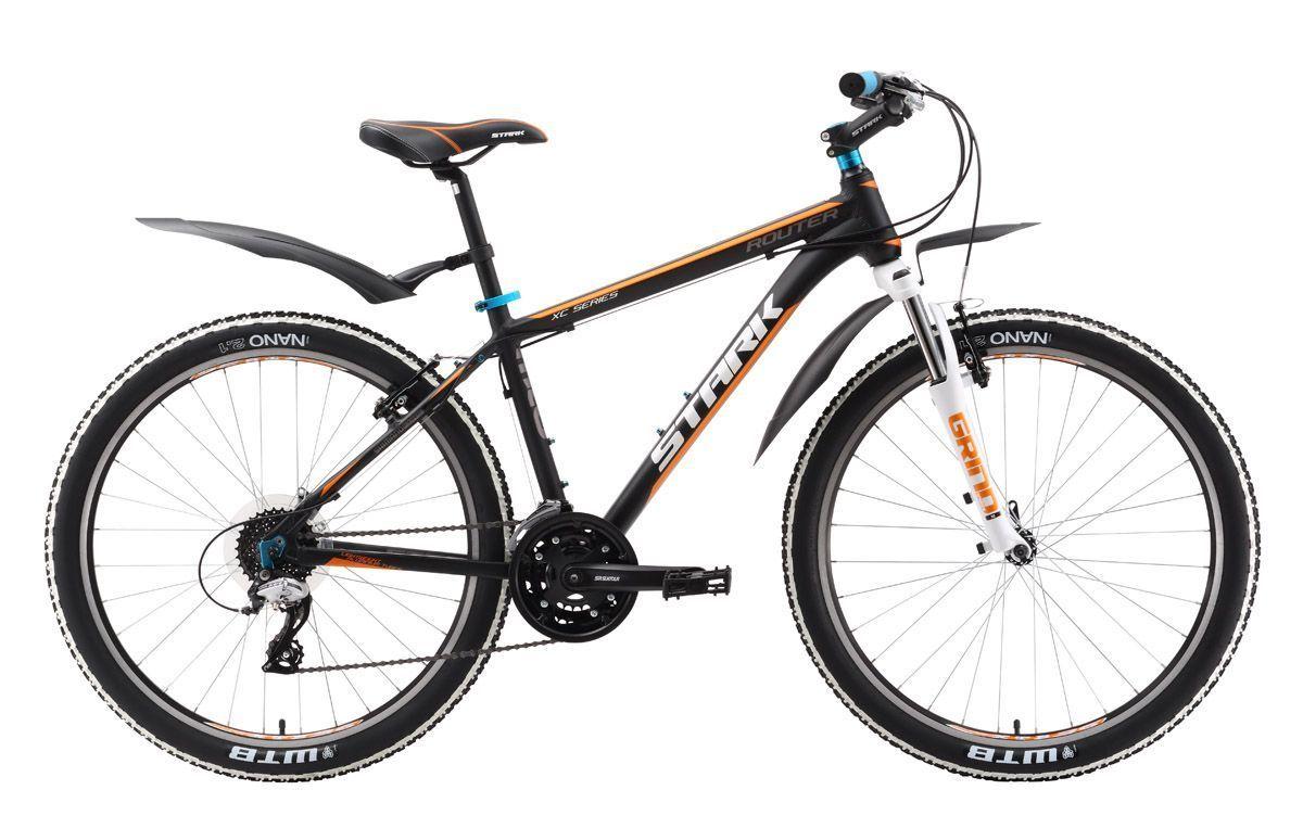 Велосипед Stark Router (2016) бело-красный 18КОЛЕСА 26 (СТАНДАРТ)<br>Горный велосипед Stark Router имеет большую выносливость и запас прочности по сравнению с другими велосипедами, созданными для велотуризма, благодаря усиленному стакану рулевой колонки и передней вилке Spinner с ходом штока 80 мм. Этот надёжный горный велосипед будет вашим верным другом в походах выходного дня. Велосипед оборудован трансмиссией, имеющей 24 передачи и кассетой Shimano CS-HG31-8, что позволяет не только лучше подбирать передачи, но увеличивает срок службы цепи и звёзд кассеты. Переключатели Shimano Acera отлично зарекомендовали себя на туристических и прогулочных велосипедах. В 2016 году Stark Router стал ещё надёжнее благодаря улучшенной задней втулке и переднему переключателю Shimano.<br><br>бренд: STARK<br>год: 2016<br>рама: Алюминий (Alloy)<br>вилка: Амортизационная (пружина)<br>блокировка амортизатора: Нет<br>диаметр колес: 26<br>тормоза: Ободные (V-brake)<br>уровень оборудования: Любительский<br>количество скоростей: 24<br>Цвет: бело-красный<br>Размер: 18