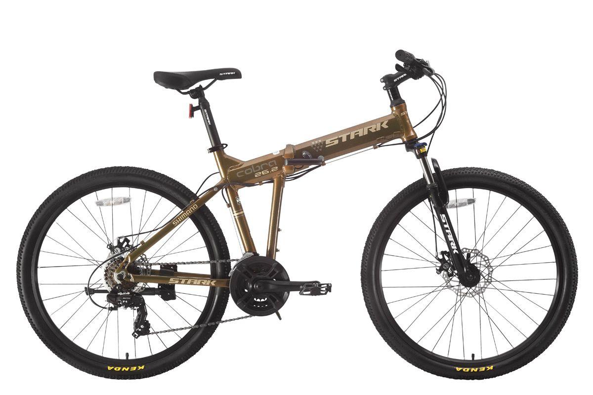 Велосипед Stark Cobra 26.2 D (2017) коричнево-желтый 19.5ГОРНЫЕ СКЛАДНЫЕ<br>Складной взрослый велосипед с полноразмерными колёсами 26 дюймов. Несмотря на свои компактные размеры в сложенном состоянии, эта модель является полноценным горным велосипедом. Данная модель оборудована алюминиевой рамой с интегрированной рулевой колонкой, мягкой передней вилкой и надёжными дисковыми тормозами с роторами 160мм. Трансмиссия велосипеда имеет 21 передачу и собрана на оборудовании SHIMANO.Так как в сложенном состоянии велосипед легко помещается в багажнике автомобиля, вам станут доступными даже самые дальние уголки природы.<br><br>бренд: STARK<br>год: 2017<br>рама: Алюминий (Alloy)<br>вилка: Амортизационная (пружина)<br>блокировка амортизатора: Да<br>диаметр колес: 26<br>тормоза: Дисковые механические<br>уровень оборудования: Начальный<br>количество скоростей: 21<br>Цвет: коричнево-желтый<br>Размер: 19.5