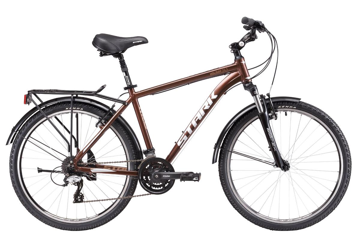 Велосипед Stark Holiday 26.3 V (2017) коричнево-серебристый 18КОМФОРТНАЯ ПОСАДКА<br>Если вы ищите прогулочный велосипед для поездок по городским улицам и паркам, обратите внимание на Stark Holiday 26.2 V, его технические характеристики и качество сборки не оставят равнодушным ни одного любителя велопрогулок. Этот дорожный велосипед укомплектован всем необходимым, его лёгкая алюминиевая рама, с крепким рулевым узлом, оборудована надёжной мягкой вилкой Suntour, с ходом 63мм, что позволяет уверенно проезжать мелкие препятствия. Потенциал этой модели насчитывает 24х скоростной режим, который легко переключается при помощи переключателя Shimano. Ободные тормоза Promax обеспечат хорошее и эффективное торможение. Амортизированный подседельный штырь и вынос руля с изменяемым углом наклона добавят комфорта вашей поездке. Приятным дополнением станет наличие полноразмерных крыльев, которые прекрасно защищают от брызг. Задний багажник, способен принять груз массой до 25 кг.<br><br>бренд: STARK<br>год: 2017<br>рама: Алюминий (Alloy)<br>вилка: Амортизационная (пружина)<br>блокировка амортизатора: Нет<br>диаметр колес: 26<br>тормоза: Ободные (V-brake)<br>уровень оборудования: Любительский<br>количество скоростей: 24<br>Цвет: коричнево-серебристый<br>Размер: 18